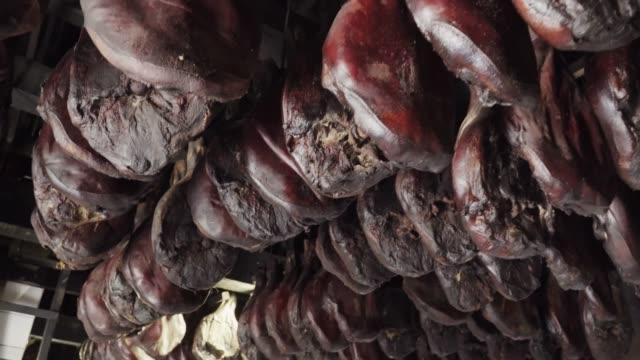stockvideo's en b-roll-footage met montenegrijnse gezouten varkensvlees of ham, prosciutto - ham