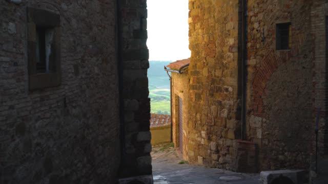 Montepulciano, Siena, Italy. Walk down the narrow city streets at sunset