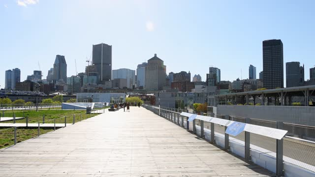 Montreal old port pier with skyline in the distance filmed on sunny May Springtime day