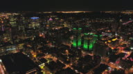 istock Montreal Quebec Aerial v115 Flying low over downtown at night panning down cityscape views 1209762845