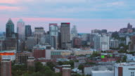 istock Montreal Quebec Aerial v141 Flying low across downtown with cityscape views at dusk 1209781464