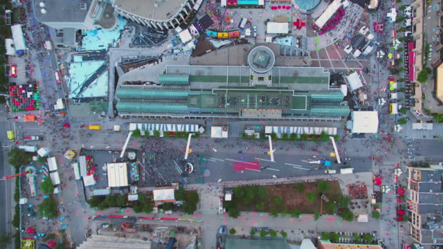 Video Montreal Quebec Aerial v74 Flying low over downtown festival looking down vertically