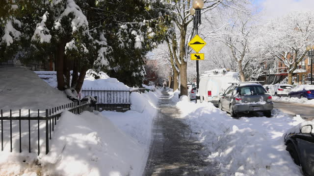 Montreal Rosemont area residential sidewalk after a snow storm