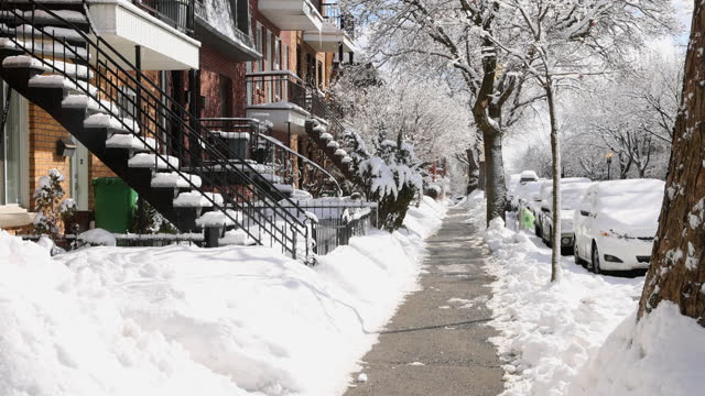 Montreal Rosemont area residential sidewalk early morning after a snow storm