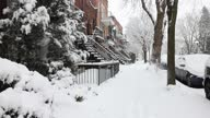 istock Montreal Rosemont area residential sidewalk early morning during a snow storm 1297257238