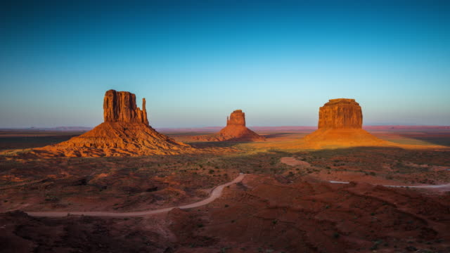 TIME LAPSE: Monument Valley, Arizona USA - Day to Dusk Day to dusk time lapse of shadows moving over the Mittens and Merrick Butte in Monument Valley navajo park. Utah / Arizona, USA. wild west stock videos & royalty-free footage