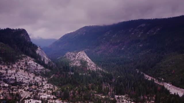 Moody California Sierra Nevada Scenery Cut by Highway 50 - Aerial View video