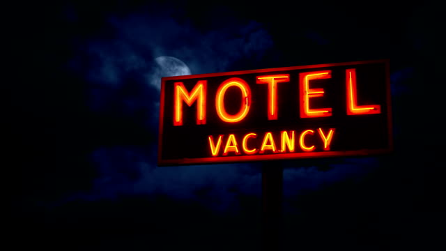 Moon Hidden In The Clouds Above Motel Sign video