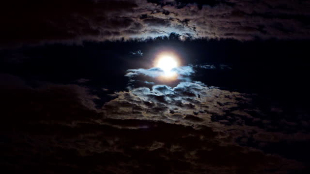 Moon is flying through the clouds video