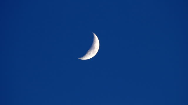Moon movement in dark evening blue sky - time-lapse video