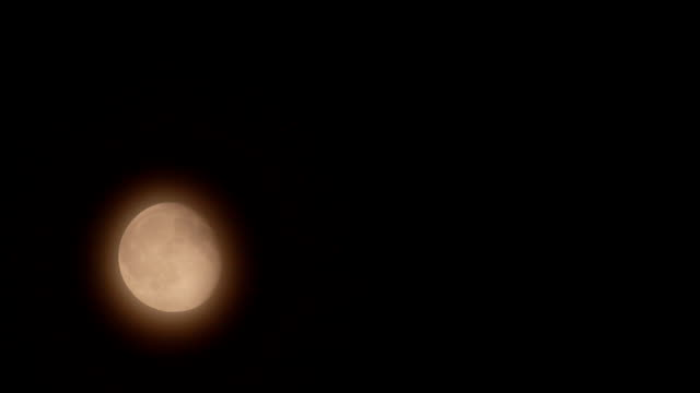 Moon movement in the mist - Night scene time-lapse video