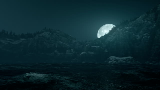 Moon over ocean and mountain ridge video
