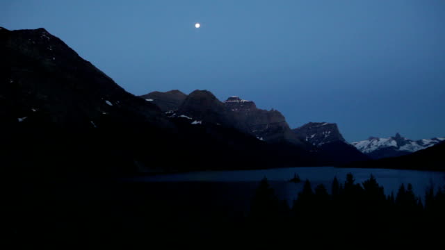 Moon over Saint Mary Lake Snowy Mountains Glacier National Park video