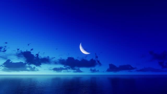 moon over water - полумесяц форма предмета стоковые видео и кадры b-roll