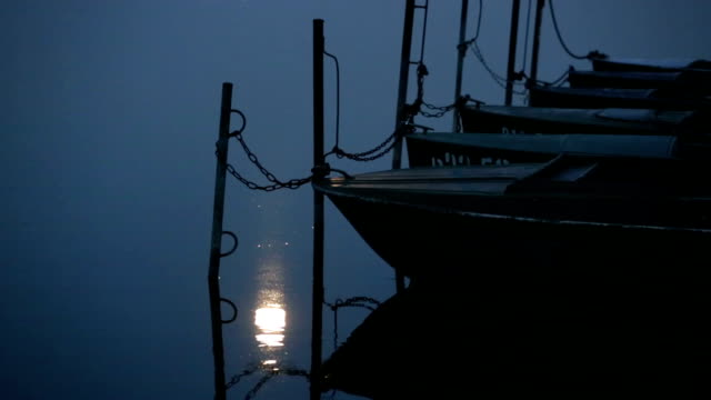 Moon reflection in sea and boats video