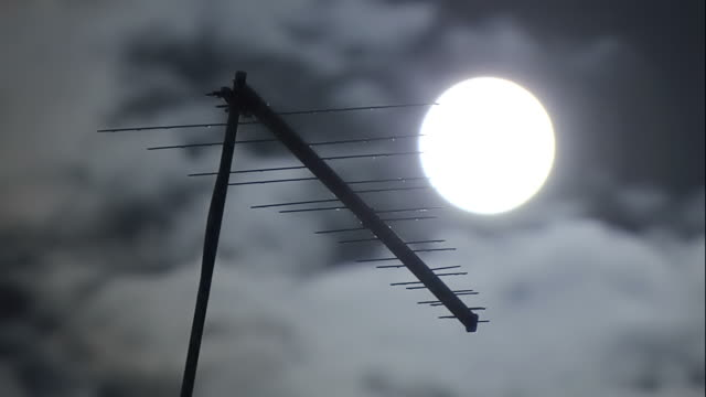 moon with clouds fast and television antenna video