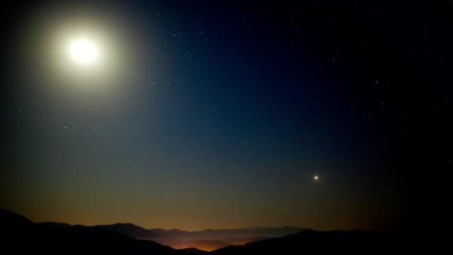 Moonlit sky time lapse video
