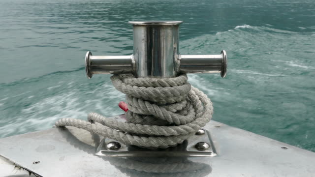 Mooring post on small boat on water