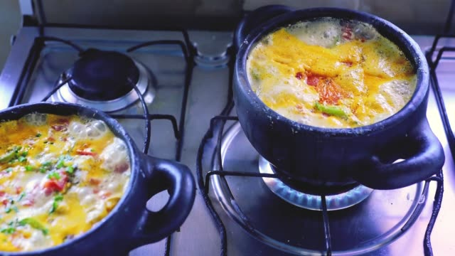 moqueca capixaba, brazilian fish stew traditional Brazilian moqueca, a delicious amazon fish stew with peppers, onions and palm oil cooked stock videos & royalty-free footage