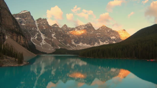Moraine Lake, Banff National Park, Canada Sunrise Timelapse A short timelapse of the sunrise hitting the Valley of Ten Peaks at Moraine Lake in Banff, Canada. rock formations stock videos & royalty-free footage