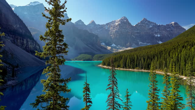 Moraine lake time-lapse morning to noon in summer sunny day.