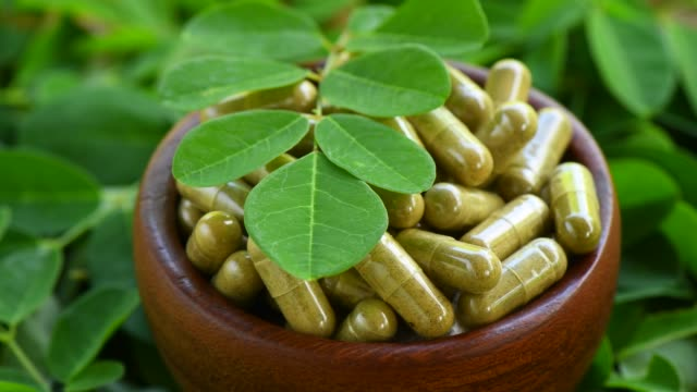 moringa capsules rotation - vitamina video stock e b–roll
