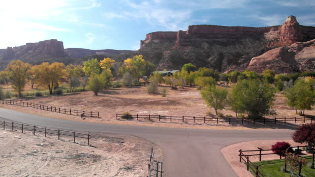 morning aerial drone footage of the famous colorado national monument with independence rock in western colorado in the fruita grand junction area - red rock video stock e b–roll