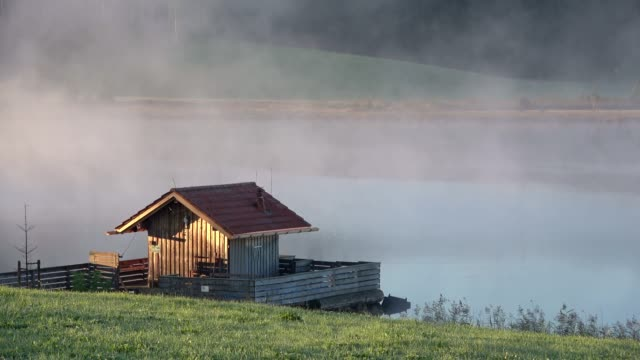 Morning at the lake with mountains, Attlesee, Nesselwang, Allgäu, Alpen, Bayern, 4K video