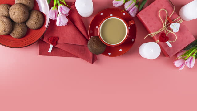 Morning cup of coffee, chocolate cake, gift or present box, candles and flower video