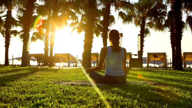 Morning meditation in the park, woman practices yoga video