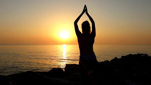 Morning meditation, woman practices yoga video