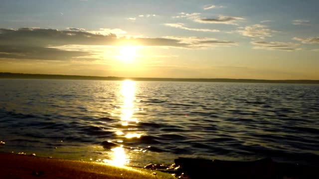 Morning on the lough. The sun has just risen. Small waves rolled on the sandy shore. video