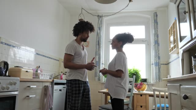 Morning routine, couple in kitchen video