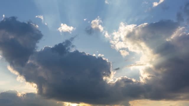 morning sun breaking through clouds, time lapse - clouds stock videos & royalty-free footage