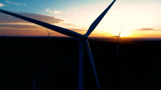 morning sun rays across the wind farm in central texas at sunrise - sustainable living stock videos and b-roll footage