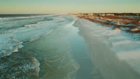 Morning Sunlight on Florida Village - Drone Shot Aerial establishing shot of Grayton Beach, Florida at sunrise. drone point of view stock videos & royalty-free footage