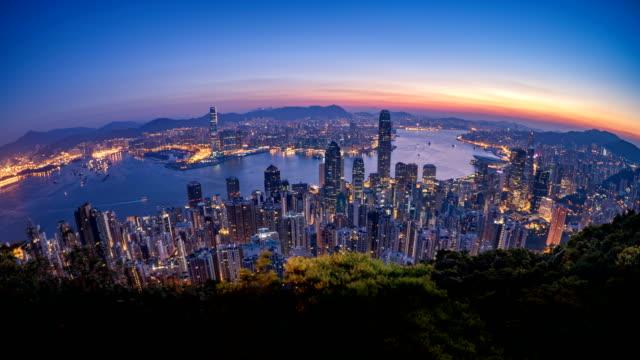 4k t\l morning sunrise over hong kong city taken from victoria peak - hong kong video stock e b–roll