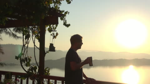 Morning Sunrise View Male Model Drinking Coffee Adult Male on a Terrace Deck with an Amazing Panoramic View is Drinking a Cup of Coffee. Shot in Lake County California. morning stock videos & royalty-free footage