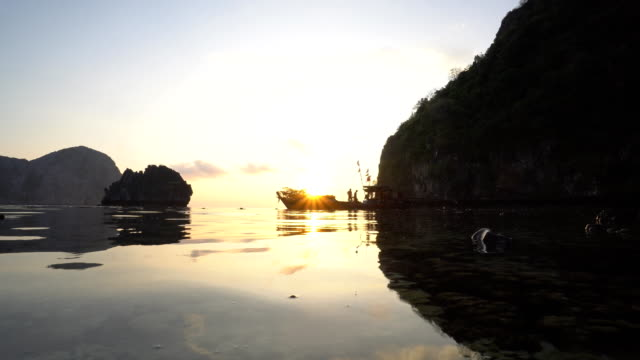 morning sunrise with fishermen activity on their boat video