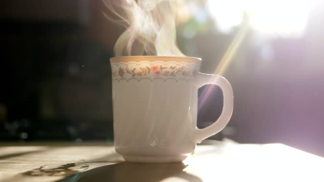 morning tea. steam evaporates in slow motion - tea cup stock videos & royalty-free footage