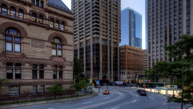 Morning Traffic moves in the city center in Toronto The Morning Traffic moves in the city center in Toronto east stock videos & royalty-free footage