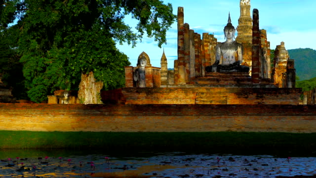 WS, TU, morning view of Sukhothai Historical Park at Mahathat temple reflecting in water wide shot, tilt up, morning view of Sukhothai Historical Park at Mahathat temple reflecting in water, Thailand sukhothai stock videos & royalty-free footage