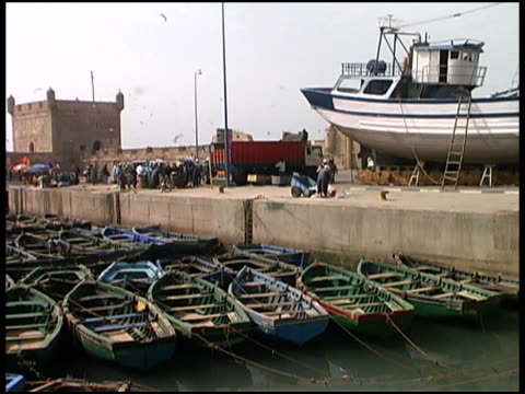 Morocco Docks, Port, Jetty, Boats and Castle Morocco Docks / Port / Jetty / Boats and Castle.  SD 4:3 NTSC 720 x 486 with 29.97 fps. Natural background audio. water bird stock videos & royalty-free footage