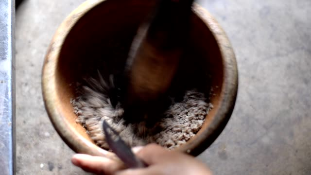 Mortar and pestle Grinding fish meat in wooden mortar and pestle mortar and pestle stock videos & royalty-free footage