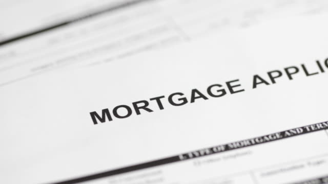 Mortgage Application - 4K A 4k resolution stock video of a Mortgage Application form. mortgages and loans stock videos & royalty-free footage