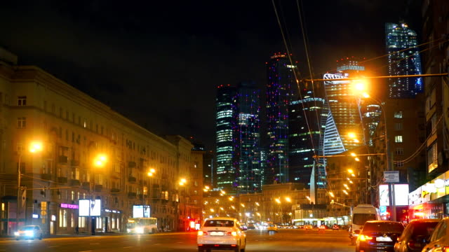 Moscow street traffic and 'Moscow city' business district skyscrapers at night video