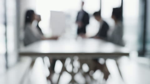 Most successful visions first start out as a blur 4k blurred video footage of a group of businesspeople planning and having a meeting together inside a modern office defocused stock videos & royalty-free footage