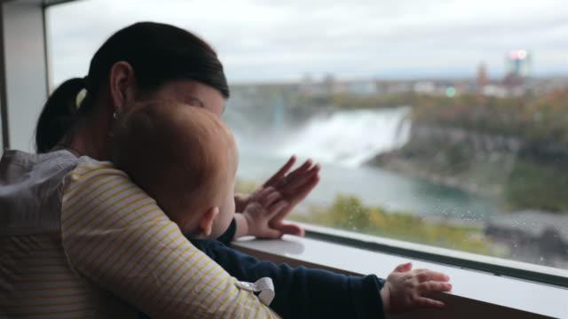 mother and baby boy at niagara falls - ontario canada video stock e b–roll
