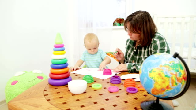 Mother and Baby Painting In Playroom​ video