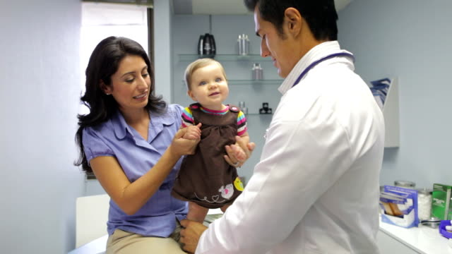 Mother And Baby Visiting Doctor's Office video